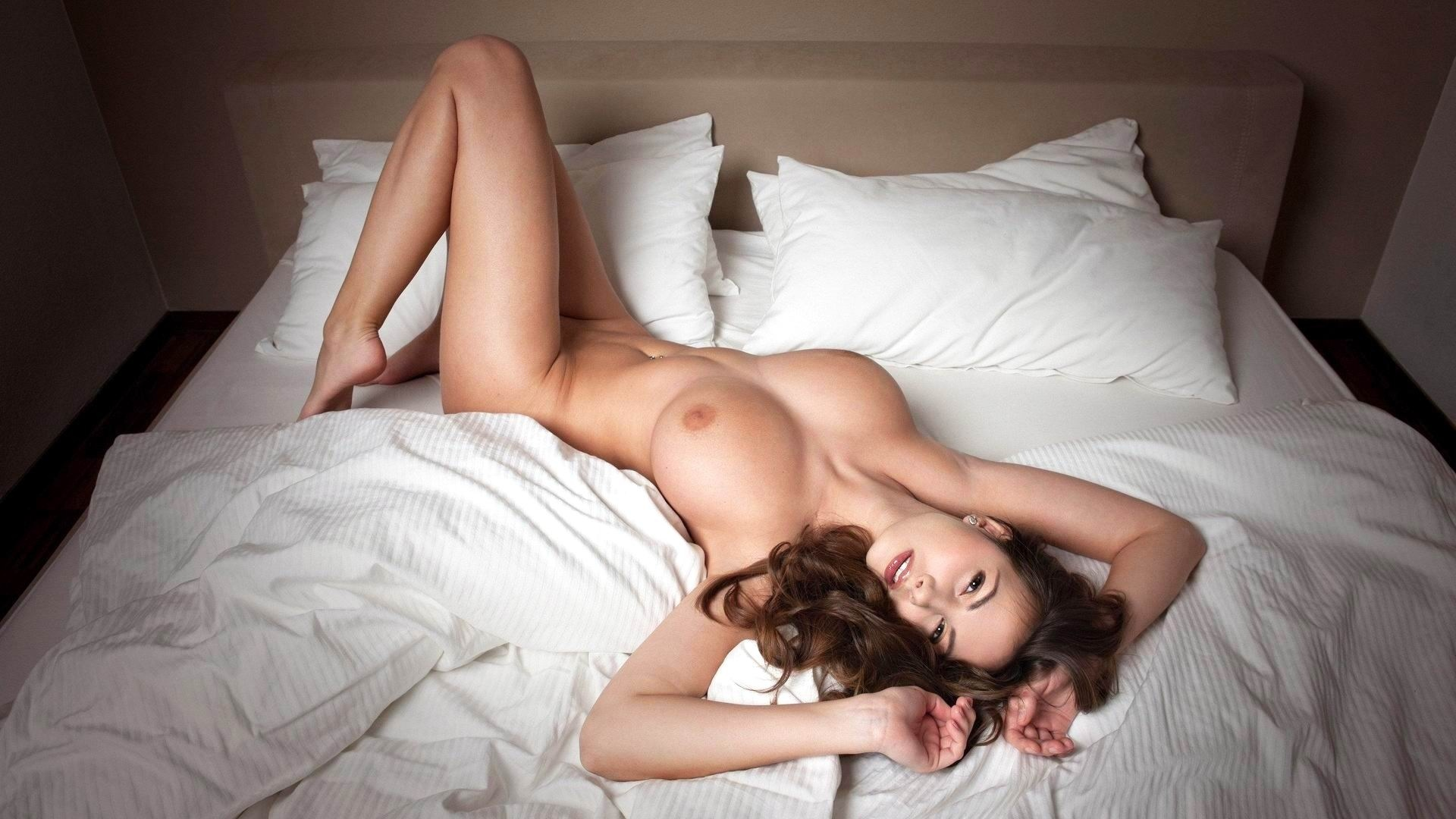 Naked woman laying on top of naked man stock photo